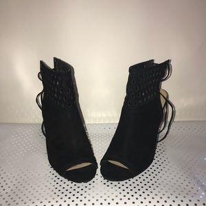 Black chunky heels.